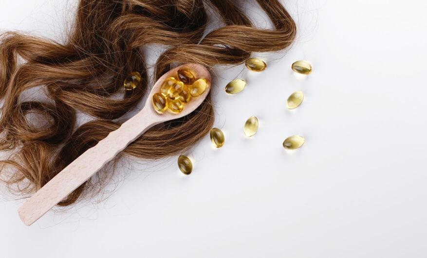 Vitamin E có tác dụng làm mềm và kích thích mọc tóc